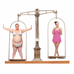 Overweight and slim. Balance scale with two young women.