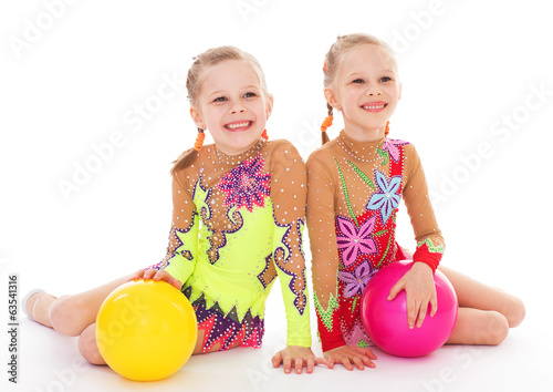 adorable twin girls gymnasts.