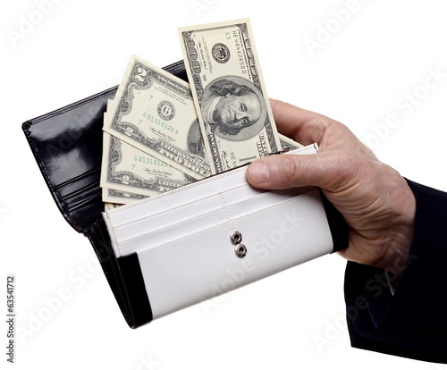 hand holding wallet with money