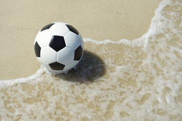 Brazilian Beach Soccer Football in the Wave
