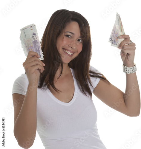 Young woman smiling with money in her hands