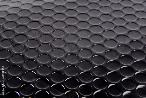 black circle textured background
