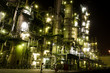 Column tower in petrochemical plant at night