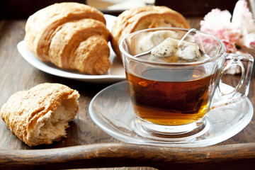 Tea in Transparent Cup with Croissants