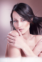 Seductive woman with bare shoulder.