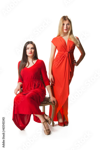 two women in long red dress