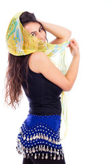 Beautiful young woman with a shawl partially covering her face o