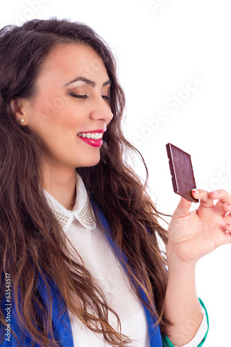 Beautiful woman tempted by chocolate