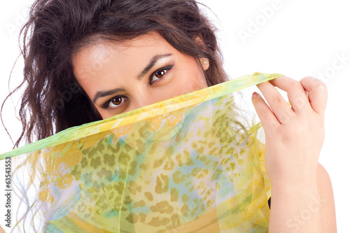 Beautiful young woman with a shawl partially covering her face