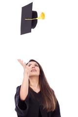Beautiful female student throws up his graduation cap in celebra