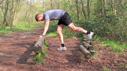 Young man working out in the forrest