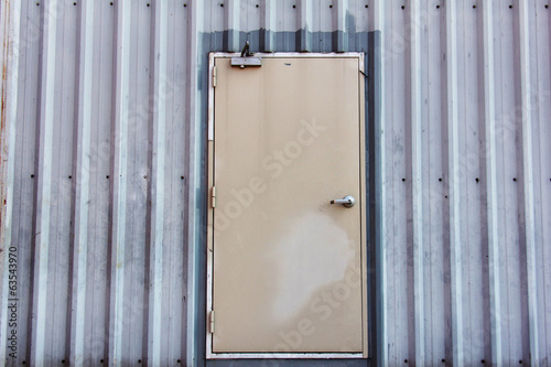 iron door on corrugated metal sheet
