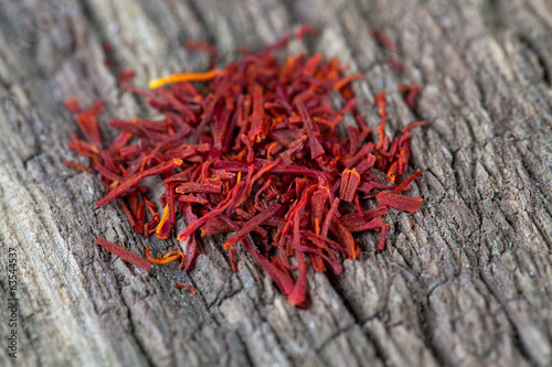 pile of saffron on rustic wooden surface