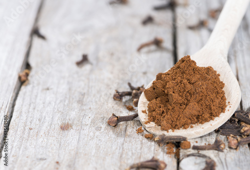Clove Powder on a wooden spoon