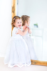 Beautiful toddler girl in a white dress