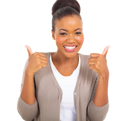 young african girl showing thumbs up