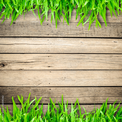 Green grass on wooden board and copyspace for text