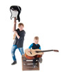 two boys with guitars on a box