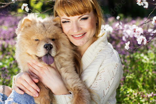 Portrait of a woman with her dog outdoors