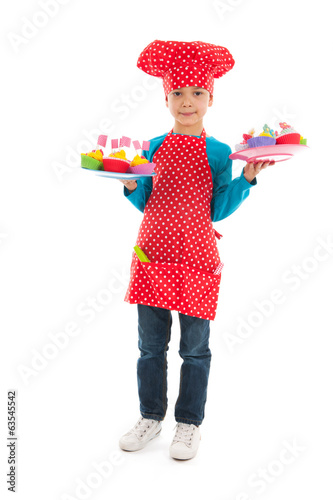 Studio portrait boy as little cook
