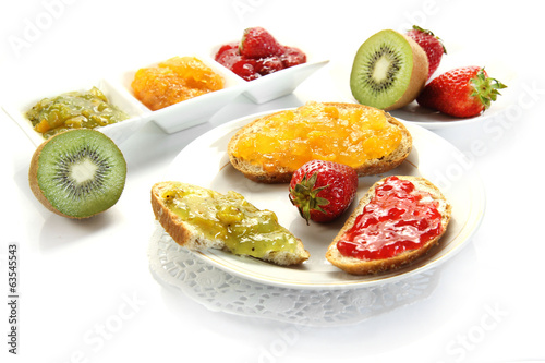 jam with slices of bread on white background