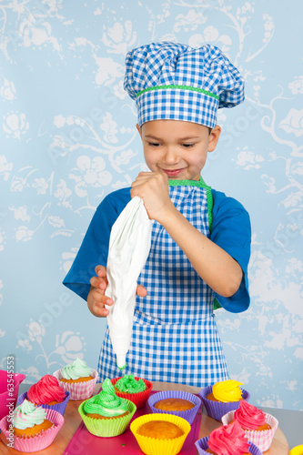 Little boy baking cupcakes