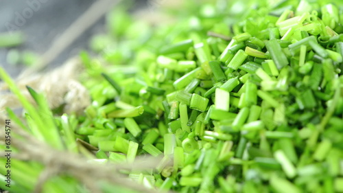 Portion of fresh cutted Chive (loopable HD video)