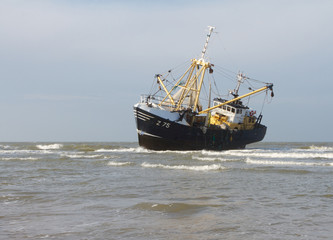 A photo of a stranded fishing boat