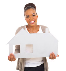 african american woman holding house symbol