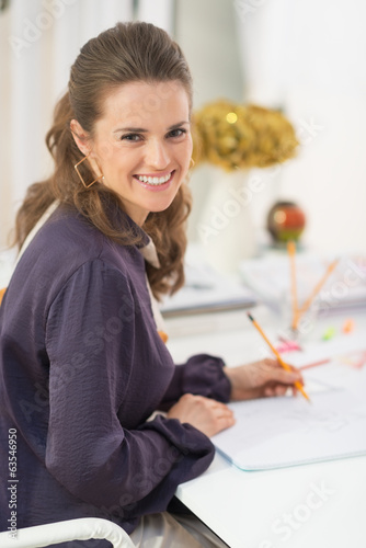 Portrait of smiling fashion designer at work