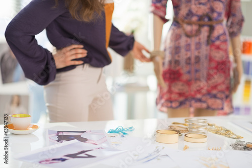 Closeup on accessories and fashion designer decorating mannequin