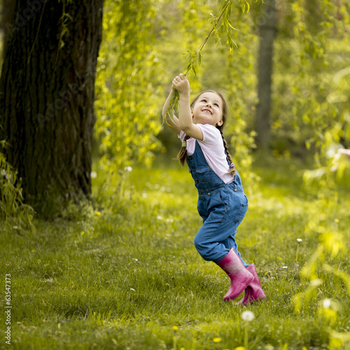 Little girl playing in the forest