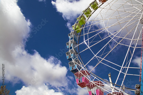cages of ferris wheel against Sky