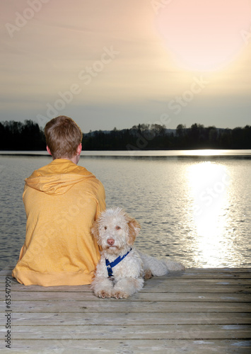 canvas print picture Teenager mit Hund am See
