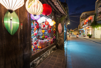 Shop with big window and colorful lanterns.