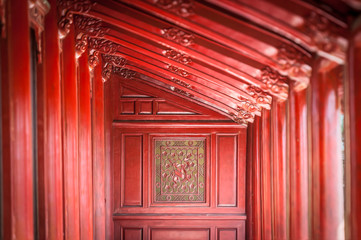 Red wooden hall in Citadel of Hue, Vietnam, Asia.