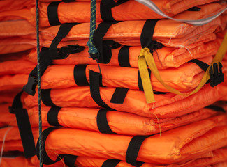 Pile of life-jackets ready for shipping.