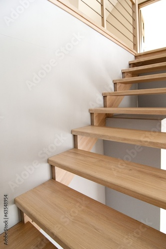 Foto op Aluminium Trappen Simple wooden interior staircase