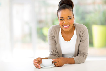 afro american woman drinking coffee