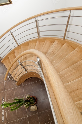 Fotobehang Trappen Wooden staircase with stainless steel elements