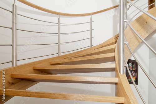 Foto op Aluminium Trappen Curved wooden staircase with stainless steel elements