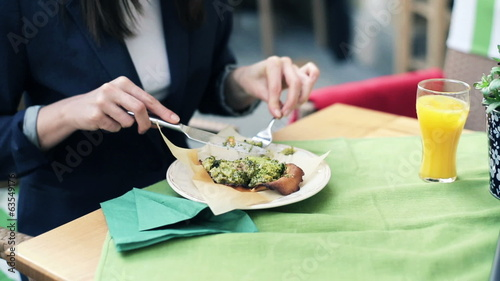 Businesswoman eating lunch in restaurant