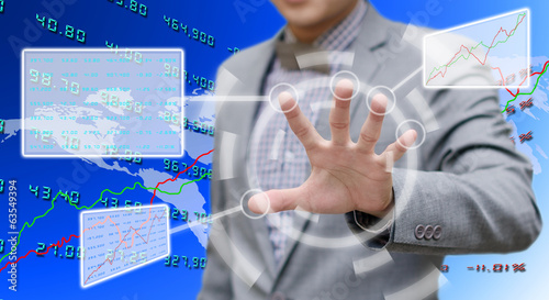 Investor analyzing data with touch screen computer
