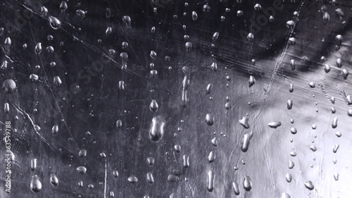 Water drops on silver metal surface.