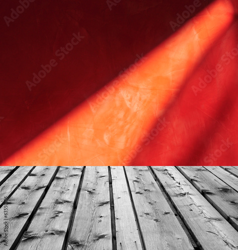 Wooden boards and red marble with light reflection