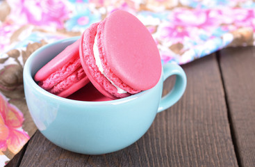 Pink macaroon in blue cup