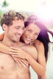 Happy romantic couple lovers on beach honeymoon