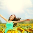 canvas print picture - Happy woman in sunflower field