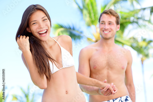 Couple fun at beach holding hands