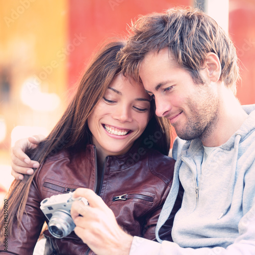 Couple looking at pictures on camera